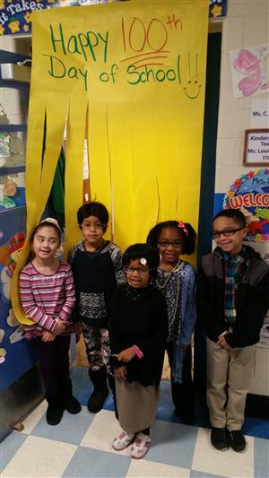 Students in front of 100th day of school sign