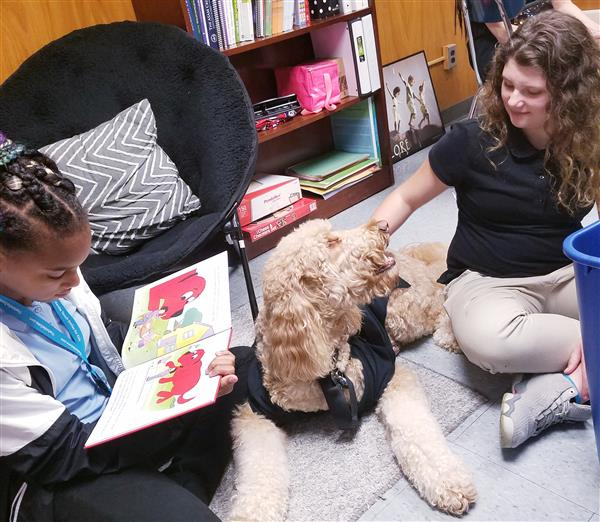 Reading to Duke the dog