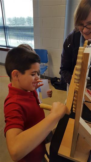 First Grader making rope